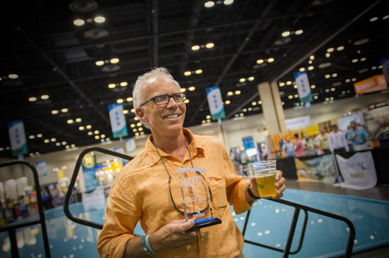 Johhny Le Coq of fishpond is all smiles after winning Best Eco-Friendly Product for IFTD 2014